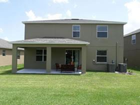 Casa Nova de 4 quartos em Condominio de Luxo com seguranca, piscina de resort, campo de golf e mais! Providence Golf Club - Davenport - Orlando $265,000